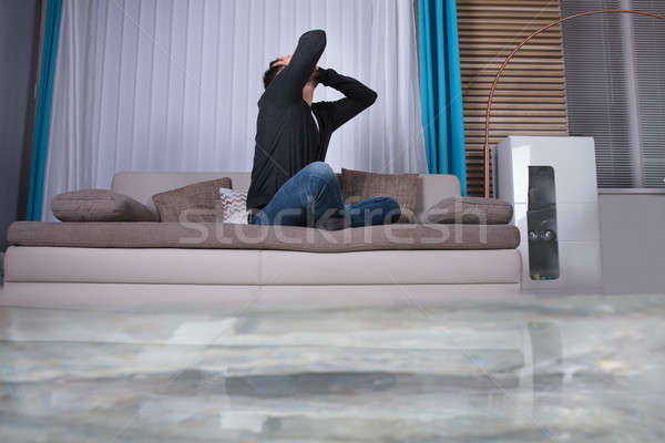 Upset Man In The Room Flooded With Water Stock photo © AndreyPopov