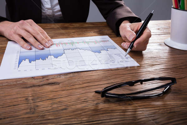 Close-up Of A Businessperson Analyzing Graph Stock photo © AndreyPopov