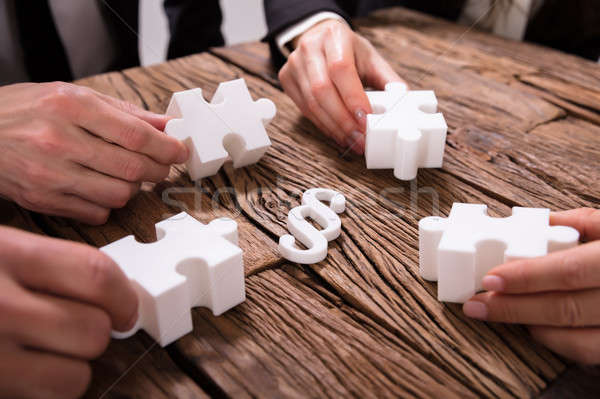 Businesspeople Hand Holding Jigsaw Puzzle Stock photo © AndreyPopov