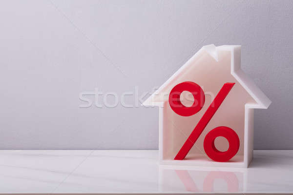 Close-up Of Red Percentage Symbol Inside House Model Stock photo © AndreyPopov