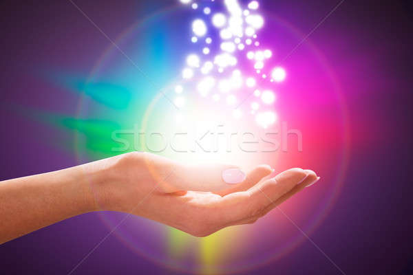Person's Hand Into Magical Healing Energy Field Stock photo © AndreyPopov