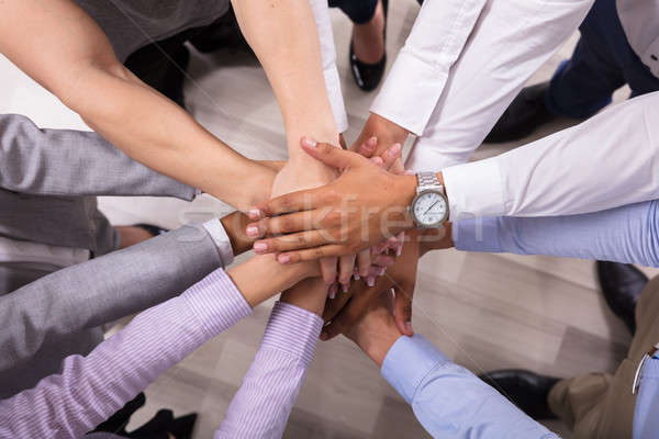 Elevated View Of Businesspeople Stacking Hands Stock photo © AndreyPopov