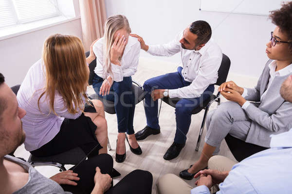 Group Of People Consoling Devastated Woman Stock photo © AndreyPopov