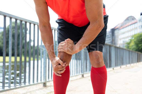 Jogger douleur genou Homme eau Photo stock © AndreyPopov