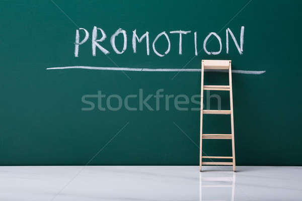 Wooden Ladder Leaning On Chalkboard Stock photo © AndreyPopov