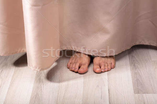 Person's Feet Behind The Curtain Stock photo © AndreyPopov