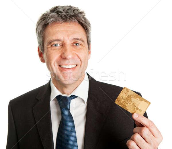 Stock photo: Businessman holding credit card