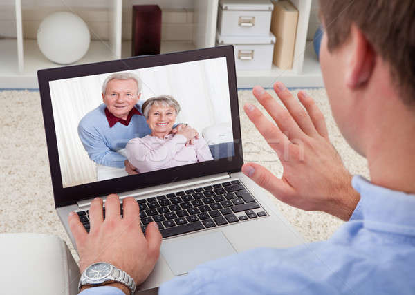 Man Video Conferencing On Laptop Stock photo © AndreyPopov