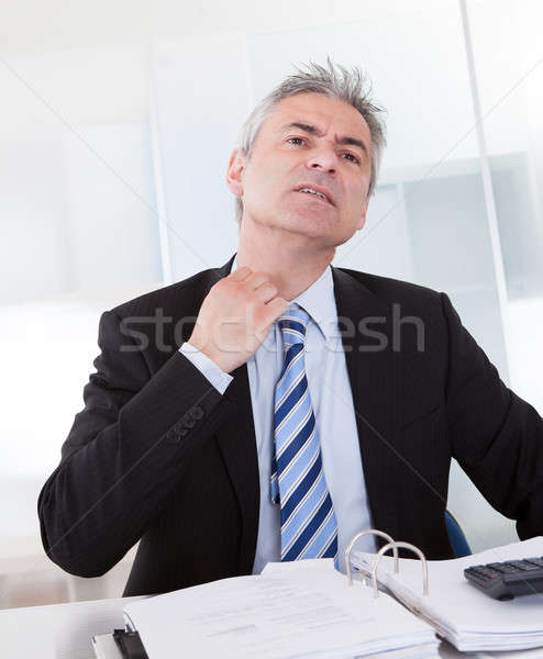 Mature Businessman Feeling Uncomfortable Stock photo © AndreyPopov