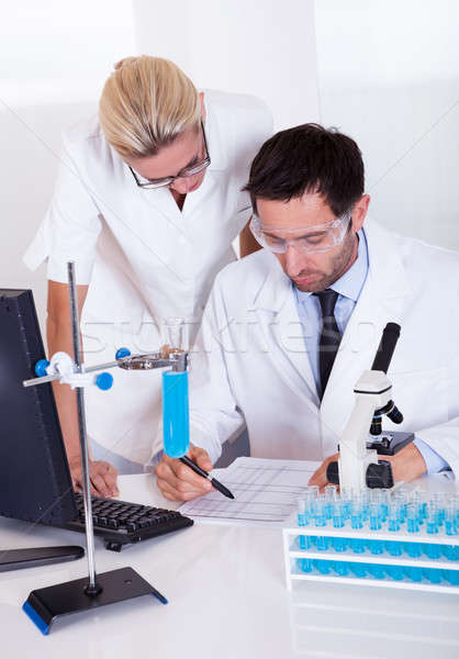 Lab technicians at work in a laboratory Stock photo © AndreyPopov