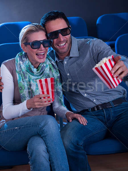 Stock photo: Lovely couple watching a 3d movie