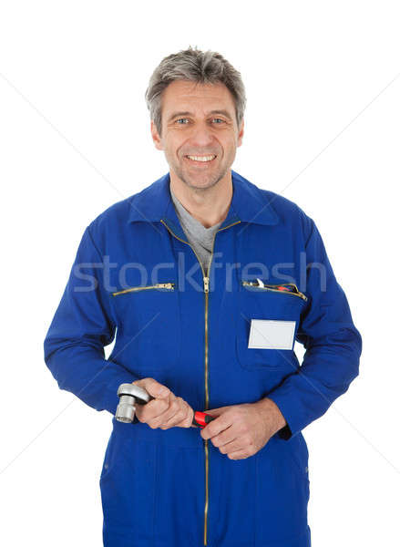 Portrait of automechanic holding a wrench Stock photo © AndreyPopov