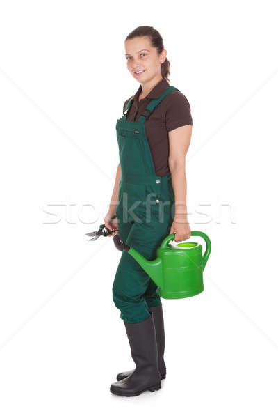 Happy Woman Holding gardening tools Stock photo © AndreyPopov