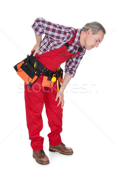 Male Technician suffering from knee pain Stock photo © AndreyPopov