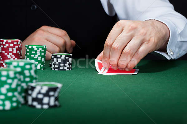 Human hand of poker player with cards and chips Stock photo © AndreyPopov