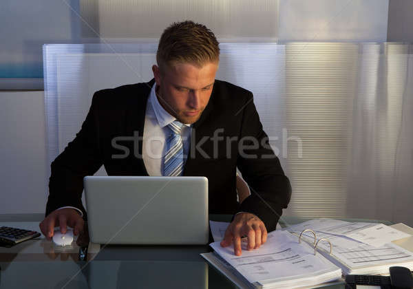 Businessman under pressure working overtime Stock photo © AndreyPopov