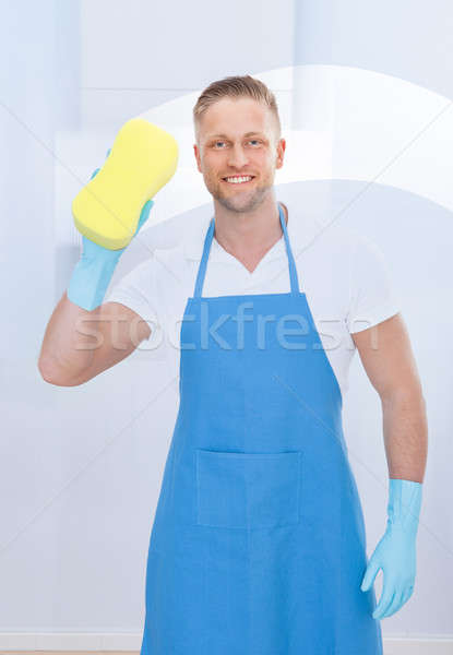 Male janitor using a sponge to clean a window Stock photo © AndreyPopov