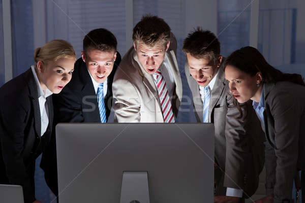 Surprised Business People Looking At Computer Monitor Stock photo © AndreyPopov