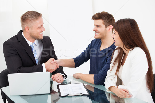 Financial Advisor Shaking Hand With Couple Stock photo © AndreyPopov