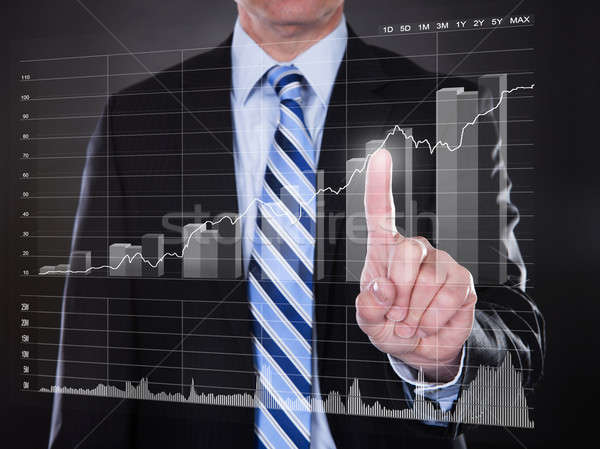 Businessman Touching Transparent Screen With Growing Bar Graph Stock photo © AndreyPopov