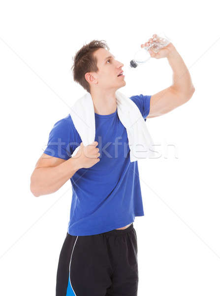 Young Man Drinking Water Stock photo © AndreyPopov