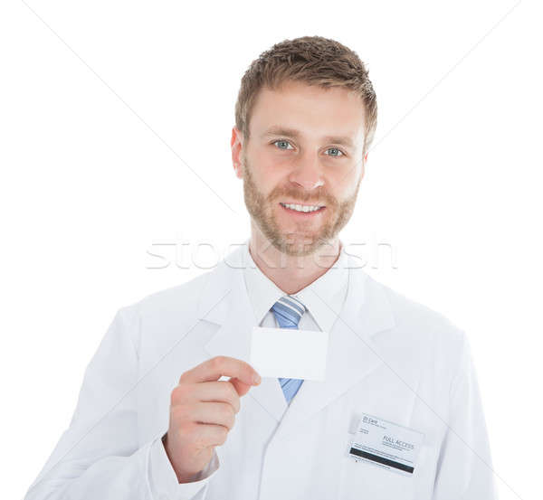 Stock photo: Mid Adult Doctor Holding Blank Visiting Card