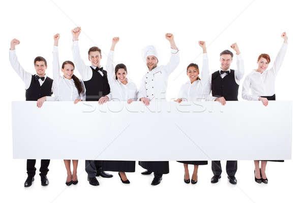Vrolijk opgewonden catering personeel tonen banner Stockfoto © AndreyPopov