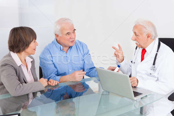 Senior Couple Discussing With Doctor Stock photo © AndreyPopov