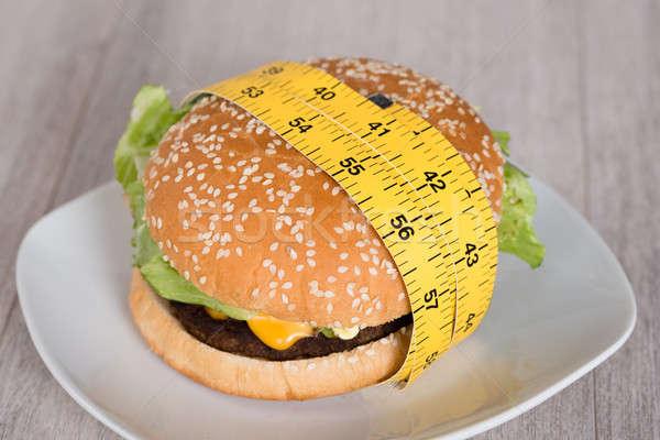 Burger рулетка пластина продовольствие хлеб Сток-фото © AndreyPopov