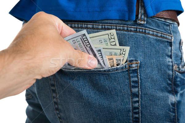 Tolvaj elvesz pénz ki hát zseb Stock fotó © AndreyPopov