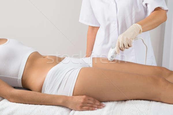 Nő epiláció lézer kezelés comb szépség Stock fotó © AndreyPopov