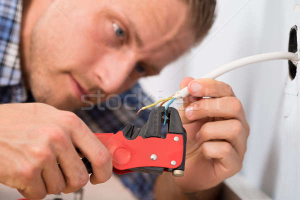 Close-up Of Electrician Stripping Wires Stock photo © AndreyPopov