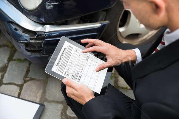Man Holding Digital Tablet Examining Damaged Car Stock photo © AndreyPopov