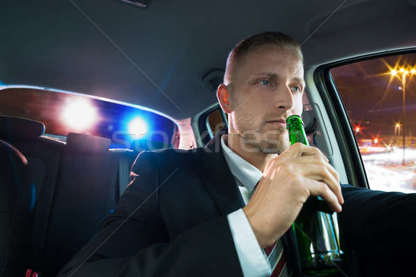 Man Drinking Beer Pulled Over By Police Stock photo © AndreyPopov