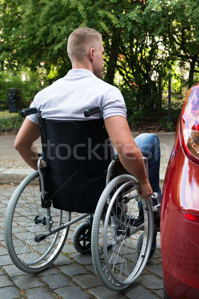 Man In Wheelchair Next To His Car Stock photo © AndreyPopov