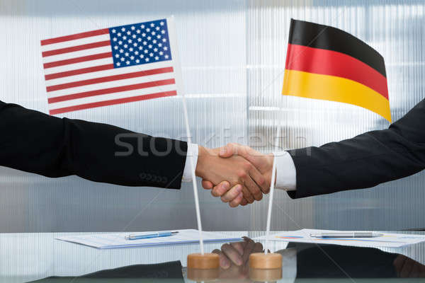 American And German Businessman Shaking Hands Stock photo © AndreyPopov