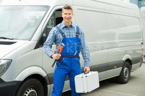 Worker With Work Tool And Toolbox Stock photo © AndreyPopov