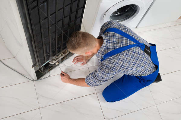 Repairman Making Refrigerator Appliance Stock photo © AndreyPopov