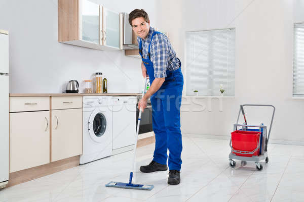 Worker Mopping Floor Stock photo © AndreyPopov