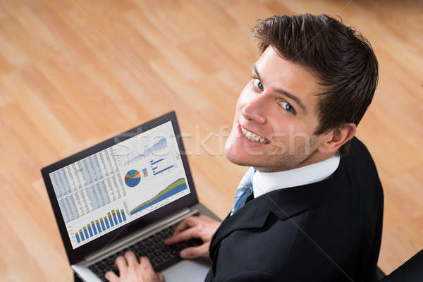 Businessman Analyzing Statistical Data On Laptop Stock photo © AndreyPopov