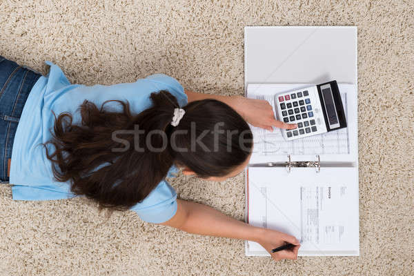 Woman On Carpet Calculating Finance Stock photo © AndreyPopov