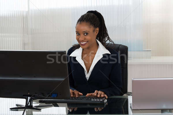Businesswoman Using Computer Stock photo © AndreyPopov