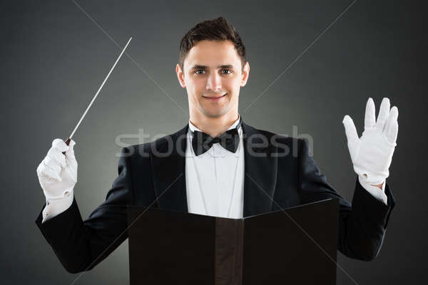 Smiling Music Conductor Holding Baton Stock photo © AndreyPopov