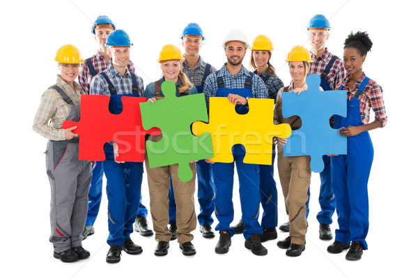 Confident Construction Workers Joining Jigsaw Pieces Stock photo © AndreyPopov