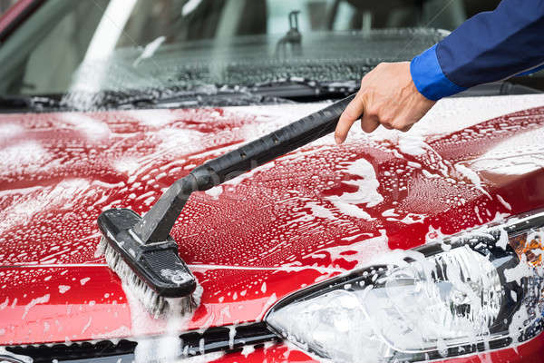 Washer Cleaning Red Car At Service Station Stock photo © AndreyPopov
