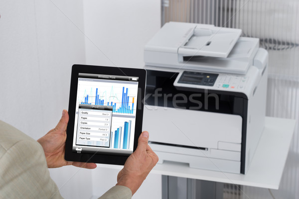 Businessman Giving Print Command On Digital Tablet Stock photo © AndreyPopov