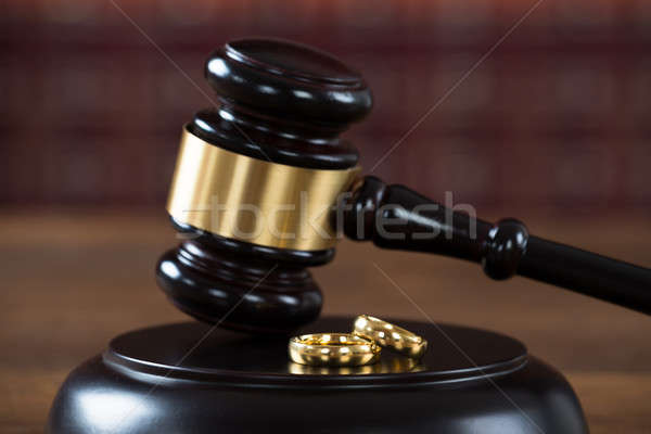 Stock photo: Wedding Rings On Mallet In Courtroom