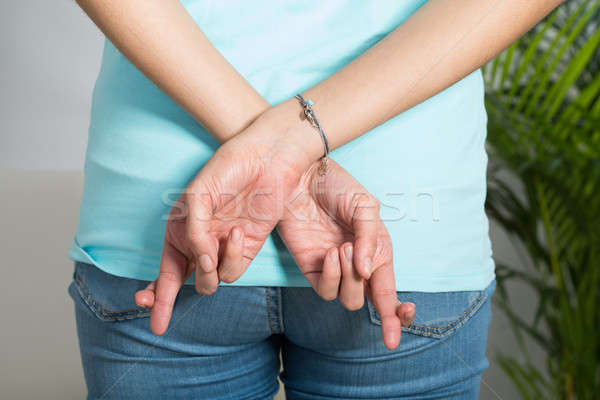 Midsection Of Woman With Fingers Crossed Stock photo © AndreyPopov