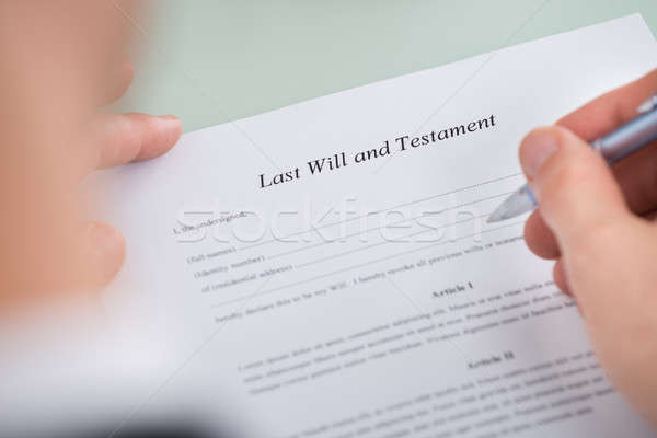 Person Hand Over Last Will And Testament Form Stock photo © AndreyPopov