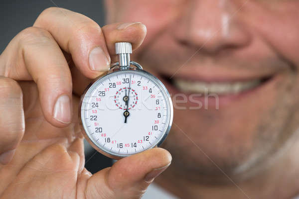 Close-up Of Businessman Hand Holding Stop Watch Stock photo © AndreyPopov